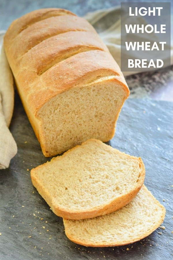 A super easy, 5 ingredient, Light Whole Wheat Bread recipe with very minimal hands on time & no special ingredients needed.  It's soft, fluffy, crusty & unbelievably good! #bread #vegan #veganbread #wholewheatbread #wholemealbread #brownbread #sandwichbread