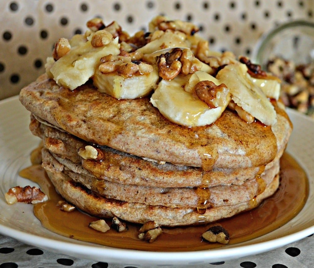 Healthier spelt banana and walnut pancakes topped with delicious maple syrup. No eggs, no dairy. You can be vegan and eat pancakes!