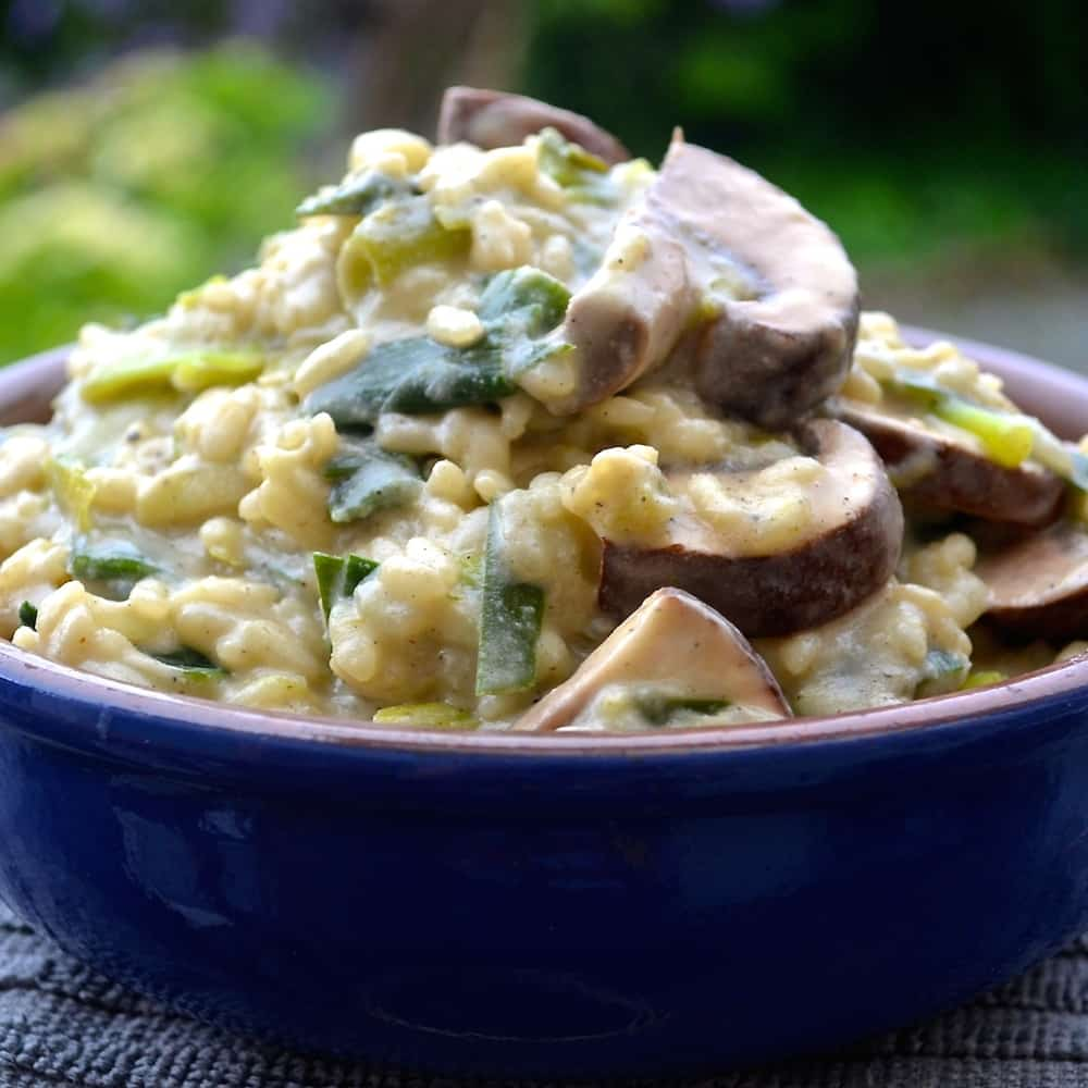 Ultra creamy italian style green garlic & mushroom risotto. It is so rich and delicious that no-one will believe that it is vegan!
