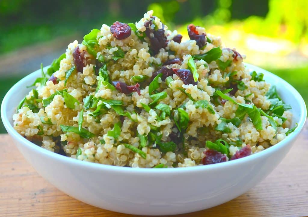 A protein packed quinoa salad with nutrient rich spinach, fresh zingy lemon and sweet dried cranberries. Delicious and healthy!