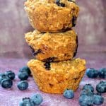 a stack of 3 blueberry breakfast bite muffins