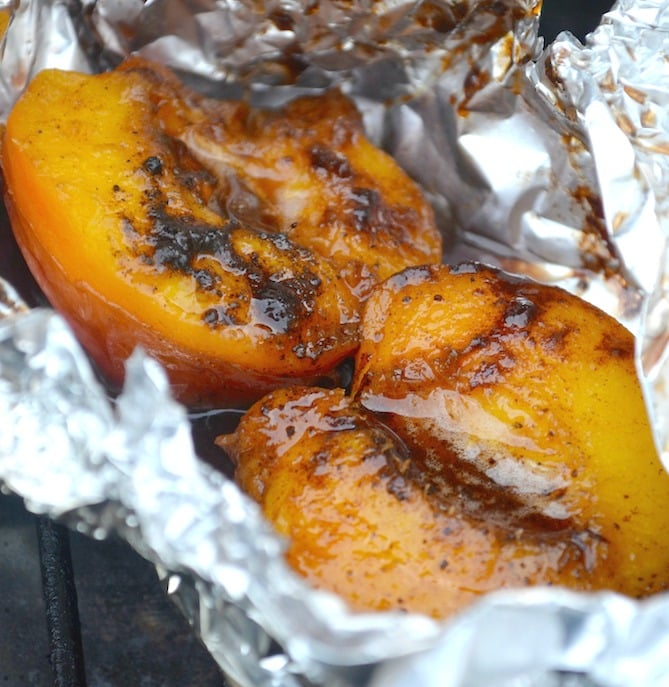 Meltingly soft plump grilled nectarines swimming in sweet buttery sauce all nestled inside an individual foil package. A perfect BBQ dessert!
