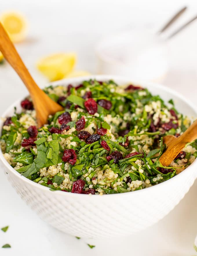 quinoa cranberry salad in large white bowl