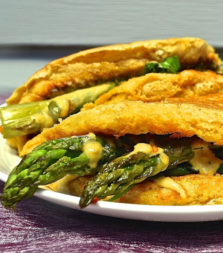 Light and fluffy vegan omelette with deep, earthy chickpea flavour, stuffed to bursting with delicious sautéed vegetables & cashew cheese.