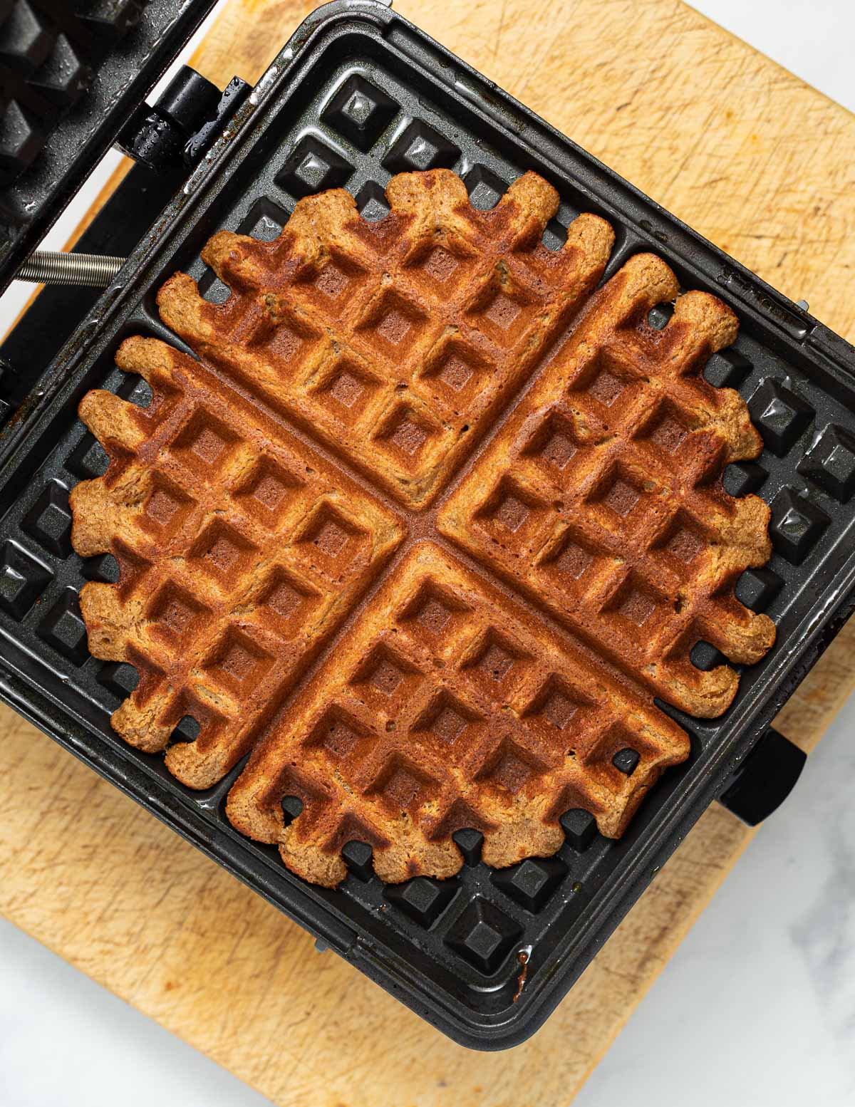 cooked waffles in a waffle iron