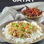 a plate of tofu satay over rice