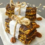 Deliciously soft & chewy, pumpkin granola bars with pecans & chocolate. Vegan, gluten free & perfect for Fall!