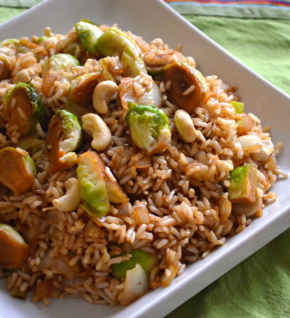 A simple, super speedy & delicious brussels sprout fried rice which brings together fresh, sweet brussels sprouts, nutty brown rice & buttery cashew nuts in a delicious tamari, maple sauce.