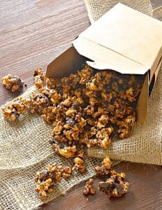 This vegan chocolate caramel popcorn is seriously addictive. Drenched in rich, buttery salted caramel, baked until perfectly crisp & then finished with lashings of chocolate, it is totally & utterly delicious & absolutely dairy free!