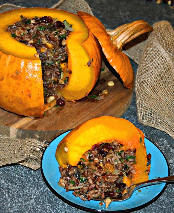 Tender, sweet, baked pumpkin stuffed with a delicious mixture of rice, vegetables, nuts & cranberries. A beautiful centrepiece for your Thanksgiving gathering!