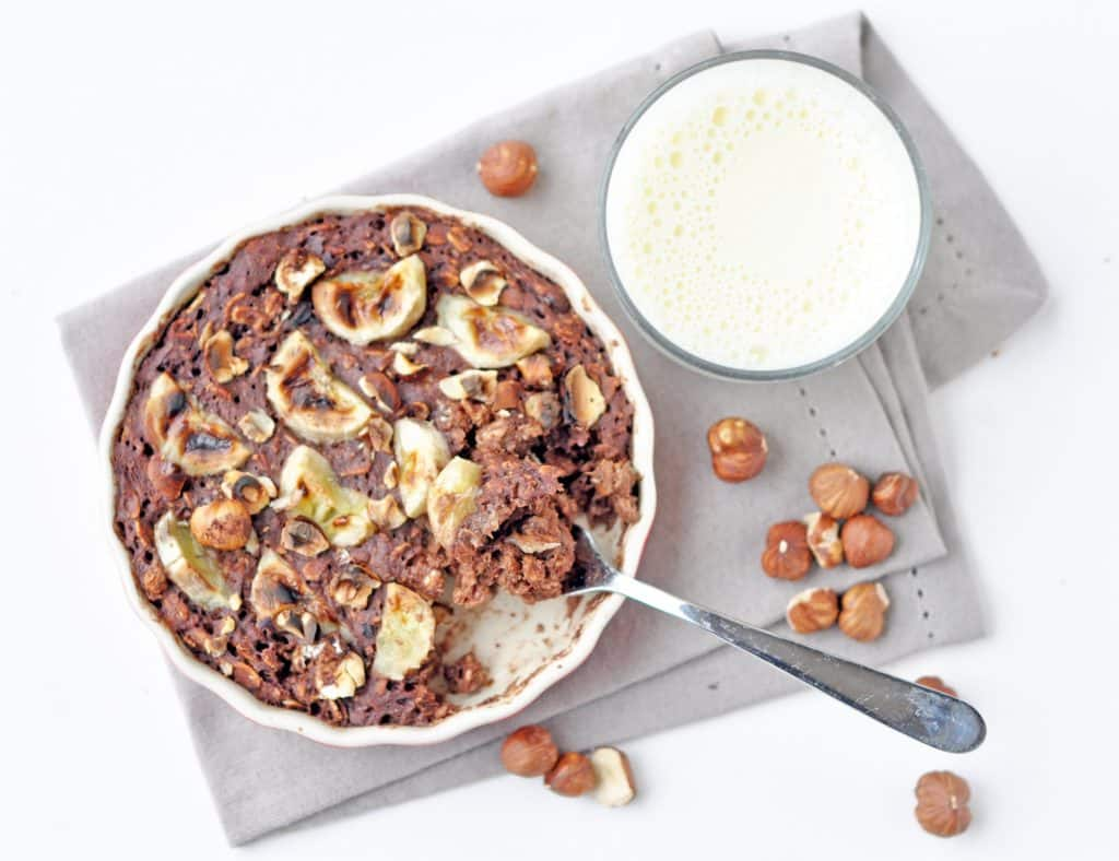 A mouthwatering Chocolate Banana Hazelnut Baked Oatmeal with a deliciously crusty exterior and a soft, creamy, chocolatey oaty interior, crunchy roasted hazelnuts and soft, sweet baked banana.