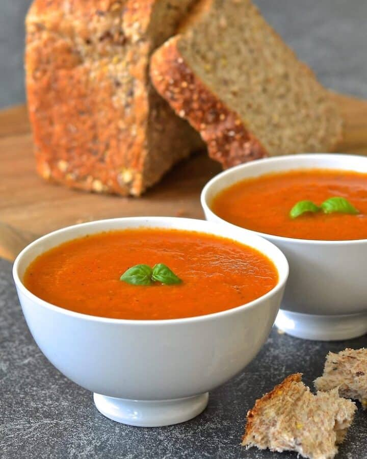 2 bowls of tomato basil soup with whole-wheat bread