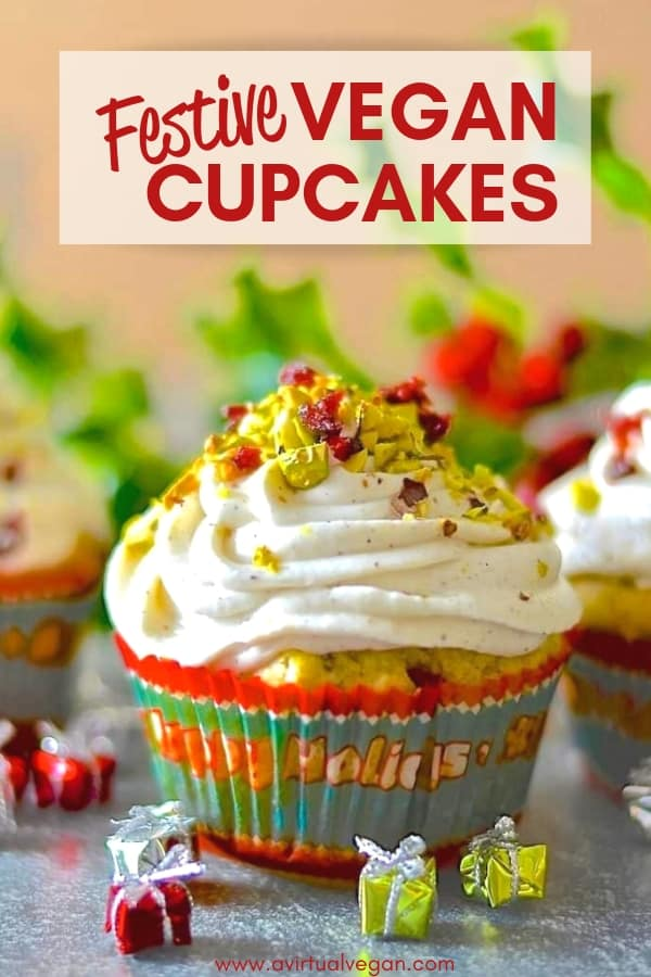Fragrant & delicious Festive Vegan Cupcakes! Orange scented, studded with juicy, jewel red cranberries & crunchy, vibrantly green pistachios & finished with a swirl of vanilla cream. #vegancupcakes #christmas