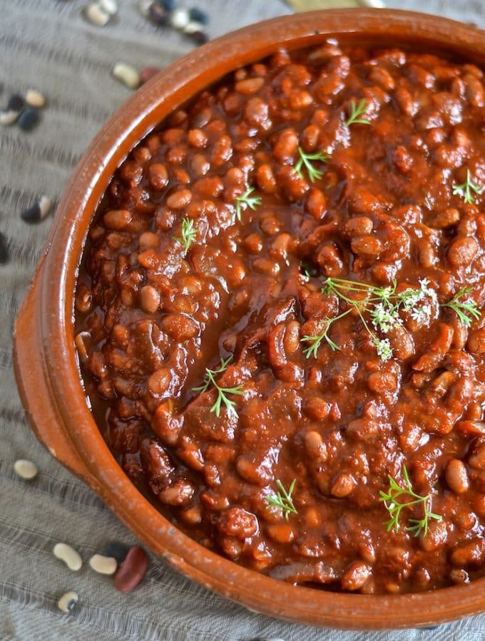 These thick, sweet & smoky slow cooked vegan barbecue baked beans need a little initial prep then you can leave them to do their thing while you do yours. You will be rewarded with a comforting & delicious pot of the most amazing baked beans with rich, deep & complex flavours.