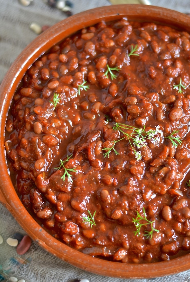 These thick, sweet & smoky slow cooked barbecue baked beans need a little initial prep then you can leave them to do their thing while you do yours. You will be rewarded with a comforting & delicious pot of the most amazing baked beans with rich, deep & complex flavours.