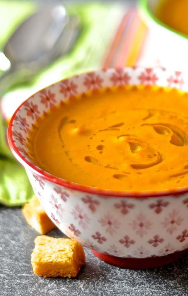 With just 4 simple ingredients you could be tucking into a bowl of this sweet & warming, velvety smooth & creamy coconut carrot & ginger soup. It's like a surprise burst of warm winter sunshine in a bowl.