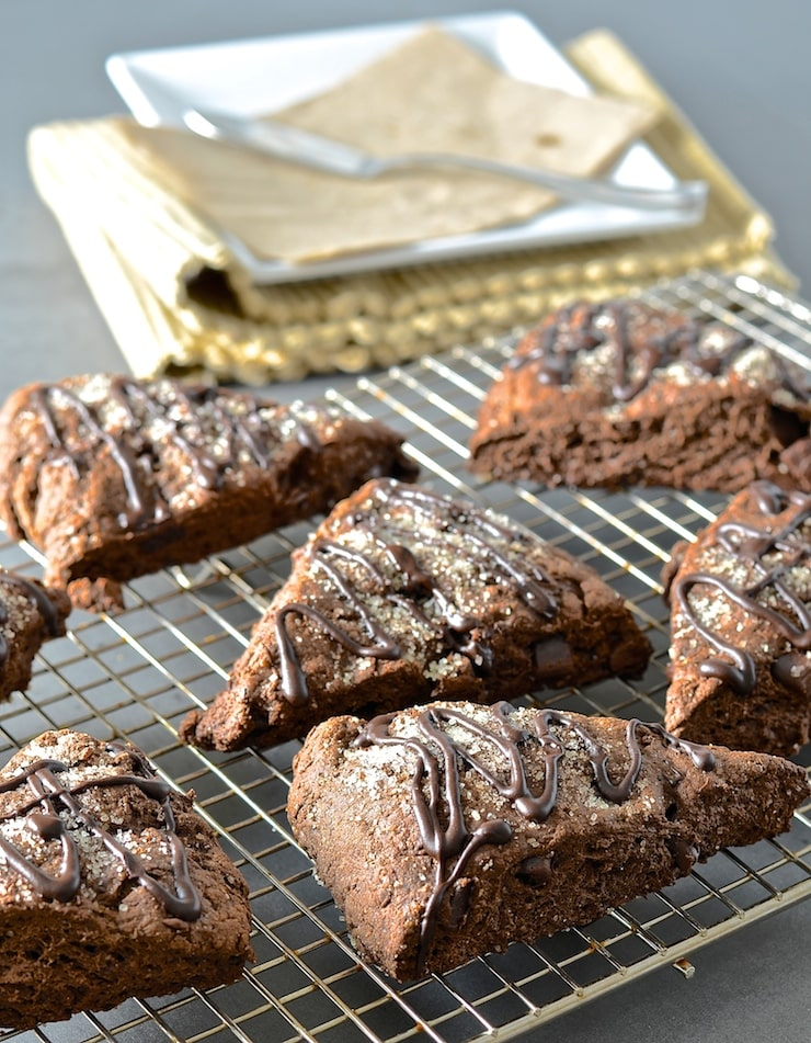 These double chocolate scones might be healthier than traditional versions but I promise there is no sacrifice in taste. Rich, dark, chocolatey & delicious with a tender cocoa enhanced crumb studded with chocolate chunks, they will satisfy the worst chocolate cravings!
