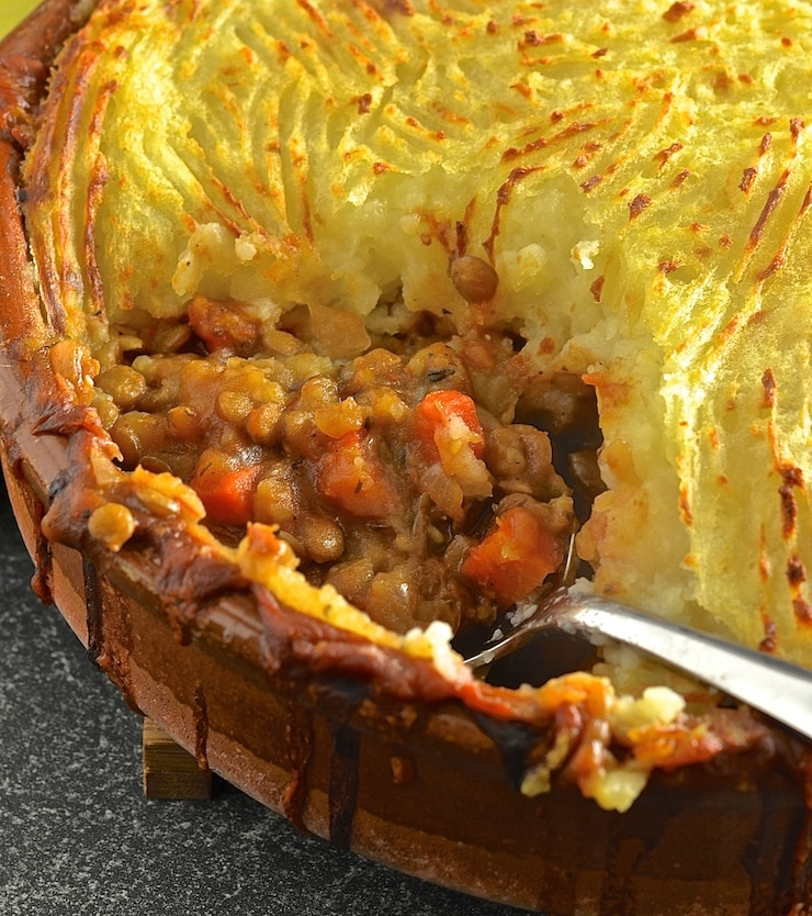 Rich, flavourful, saucy lentils topped with fluffy, creamy mashed potatoes & baked until deliciously golden brown & crispy. The ultimate vegan lentil shepherds pie!