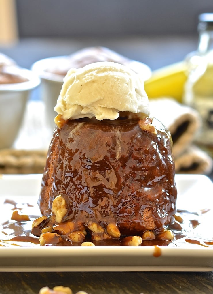 Deliciously moist & flavourful baked banana puddings with a spoon-licking, boozy, rum caramel sauce. Rich, sticky & truly indulgent!