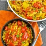 ThisOne-Pot Spicy Vegetable Rice is our go to favourite mid-week dinner. 30 minutes & one pot is all that is standing between you & a big bowl full of deliciously spiced, flavourful rice studded with sweet, soft veggies.