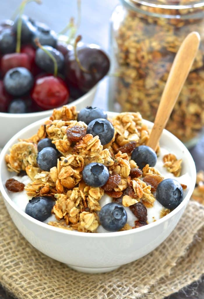 a bowl of Vegan Almond Hemp Granola with fresh blueberries