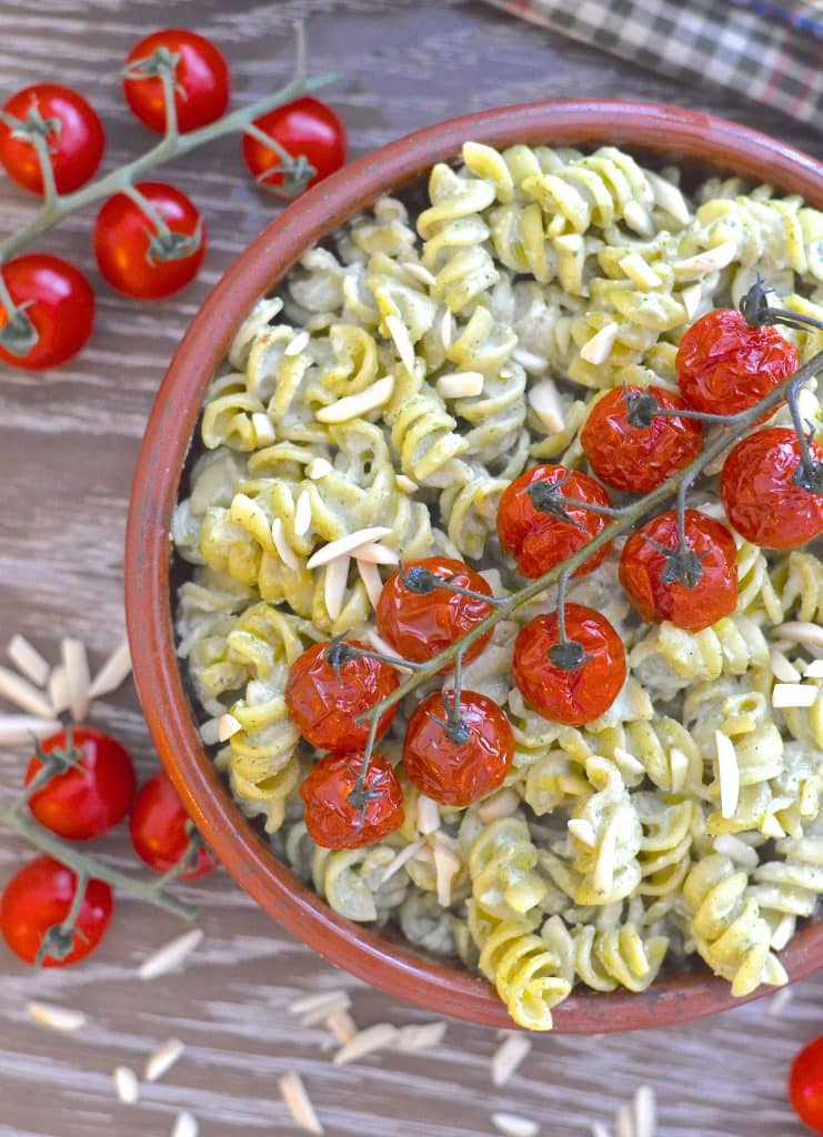 Vegan Mother's Day recipes - A simple but incredibly delicious, super creamy Vegan Pesto Pasta Salad topped with juicy, sweet, oven roasted tomatoes. It has just 5 ingredients & is ready in the time it takes to roast the tomatoes!