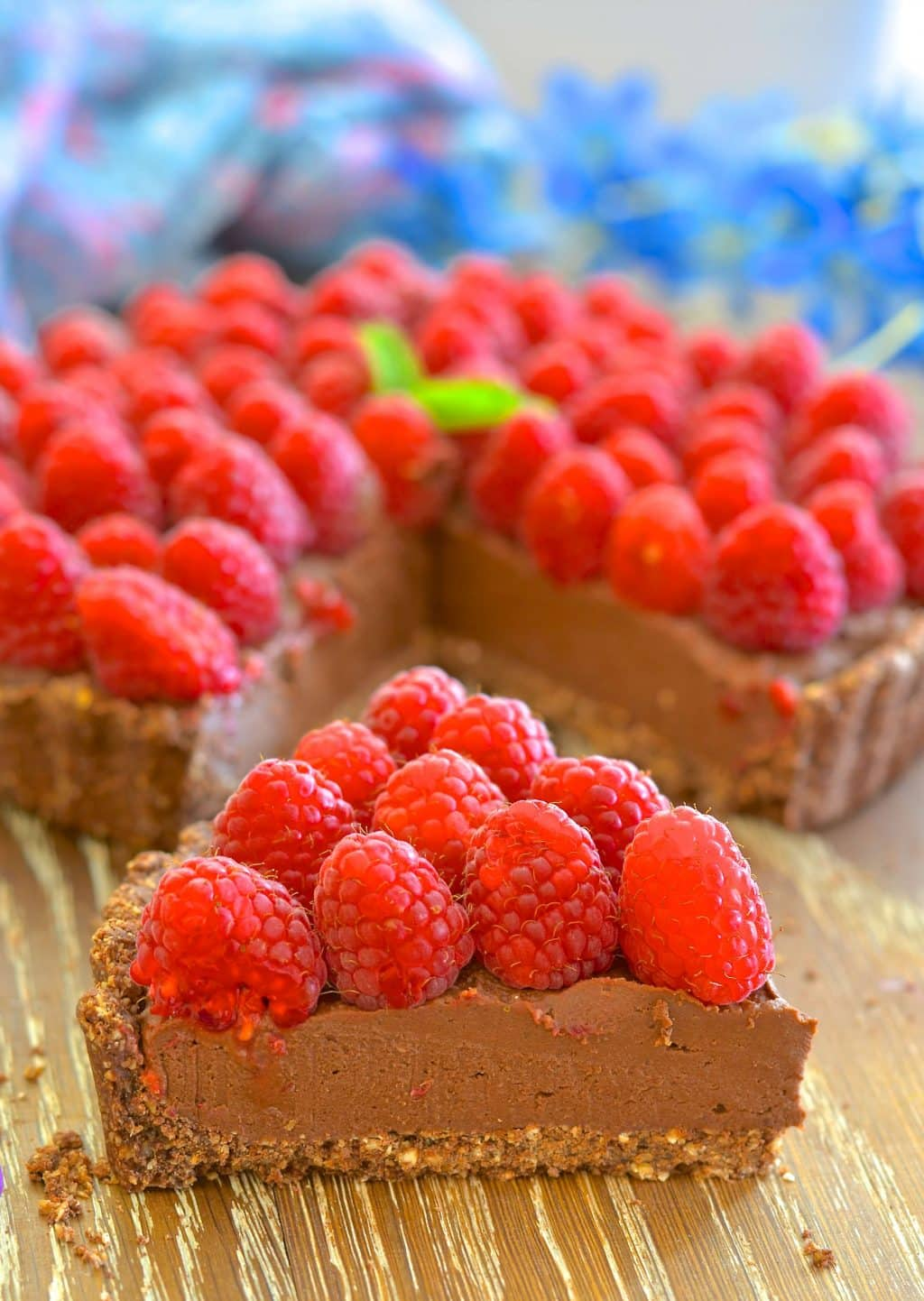 Want a dessert that looks and tastes decadent but is secretly quite good for you? I've got you covered with my Healthy Raspberry Chocolate Fudge Tart!