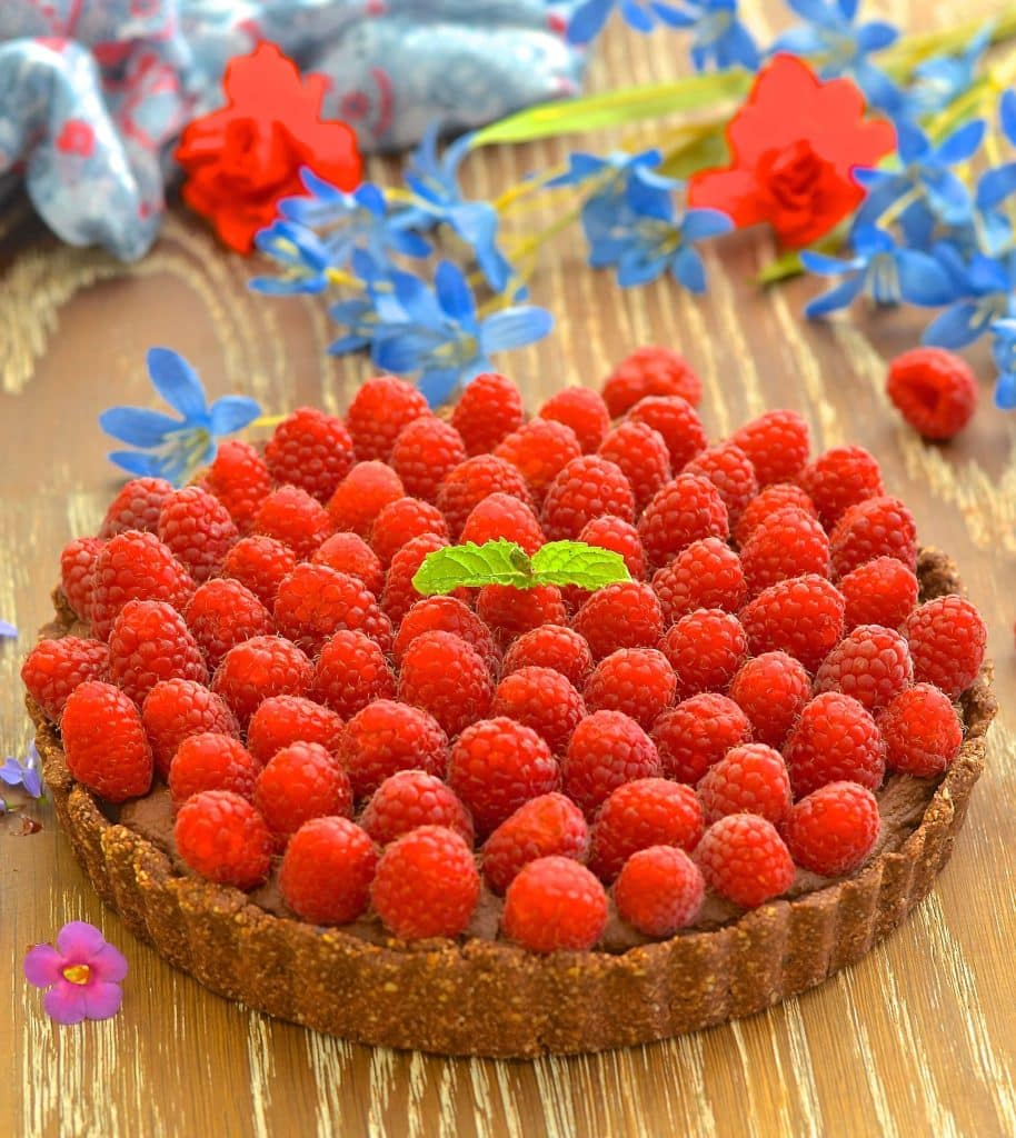 Want a dessert that looks and tastes decadent but is secretly pretty good for you? I've got you covered with my Healthy Raspberry Chocolate Fudge Tart!
