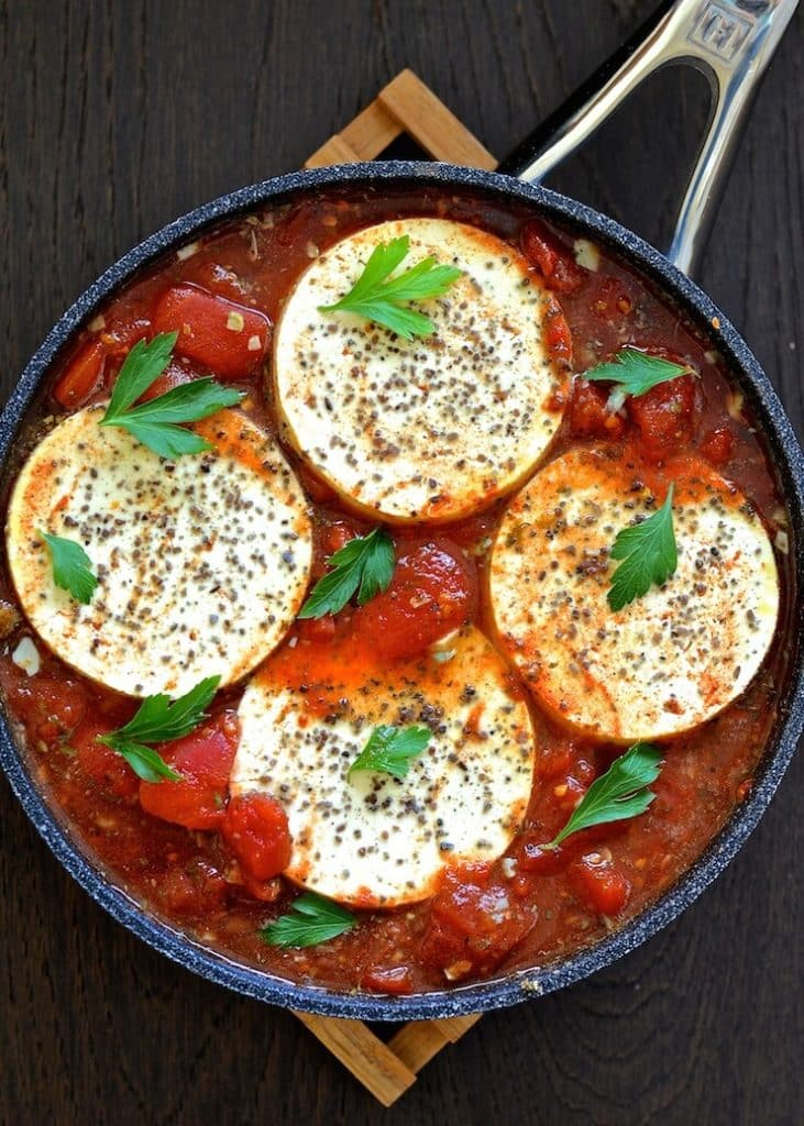Silky, soft tofu rounds cooked gently in a fiery, garlicky and chunky tomato sauce. Tofu in Purgatory is the perfect brunch dish!