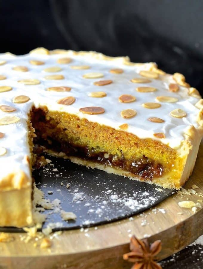 Crisp pastry, rich mincemeat, delicate spice infused sponge & brilliant white, sweet frosting come together to create a taste & texture explosion. This Festive Mincemeat Tart is indulgent, rich & just perfect for the holidays!