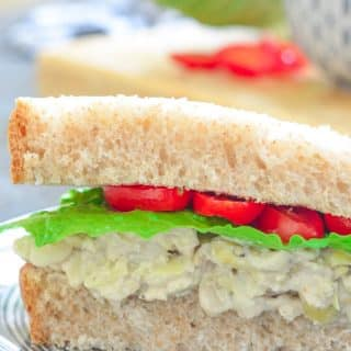 Tuck a napkin into your collar because you're gonna need it when you bite into a big, thick doorstep of a sandwich stuffed to bursting with this creamy Smashed White Bean & Artichoke Vegan Sandwich Filling!
