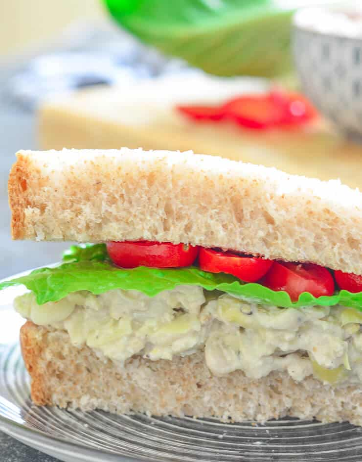 Vegan Mother's Day recipes - Tuck a napkin into your collar because you're gonna need it when you bite into a big, thick doorstep of a sandwich stuffed to bursting with this creamy Smashed White Bean & Artichoke Vegan Sandwich Filling!