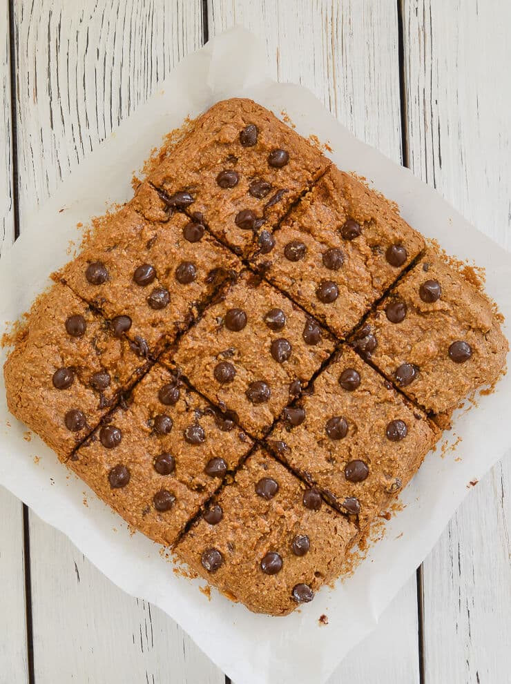 These Oatmeal Chocolate Chip Cookie Bars are perfectly soft & chewy, made healthier with oat flour & no oil, and they are absolutely delicious!