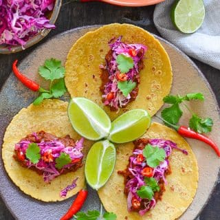 Vegan Enchilada Lentil Tacos topped with zesty lime slaw. Absolutely packed with flavour!