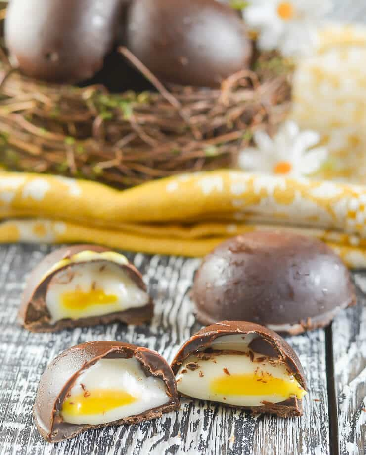 Homemade Vegan Cadbury's Creme Eggs cut open with fondant inside showing.