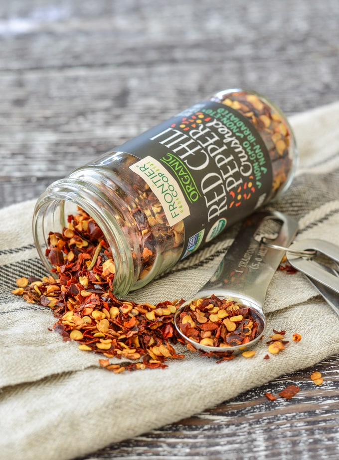 Overturned jar of Frontier Co-op Organic Crushed Red Chili Pepper flakes