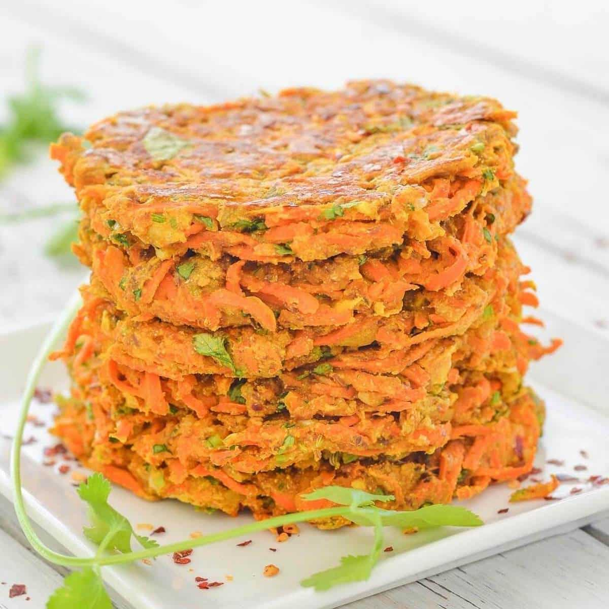 a stack of carrot fritters