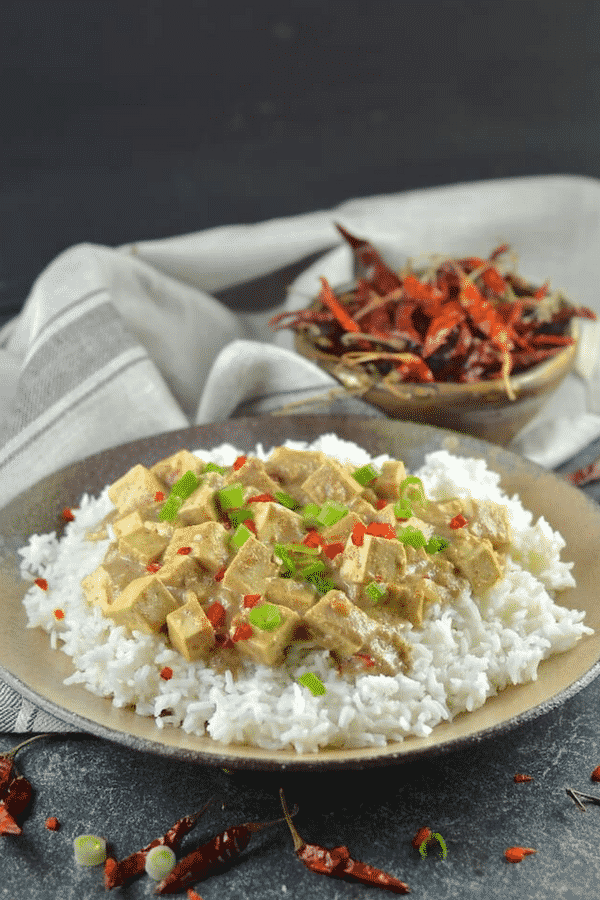 Tender tofu in a rich, smooth and creamy satay sauce. This Tofu Satay is super easy to prepare & tastes totally delicious! #tofu #satay #vegan #tofusatay #vegetarian