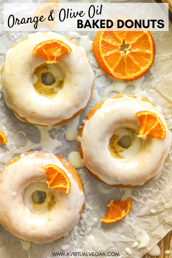 Light, fluffy and incredibly moist, these Orange Olive Oil Baked Donuts are a real taste sensation. The pungent, fruity oil balances perfectly with the orange & the sticky glaze finishes them off perfectly! #donuts #doughnuts #vegandonuts #vegan #orange #oliveoil #veganrecipe