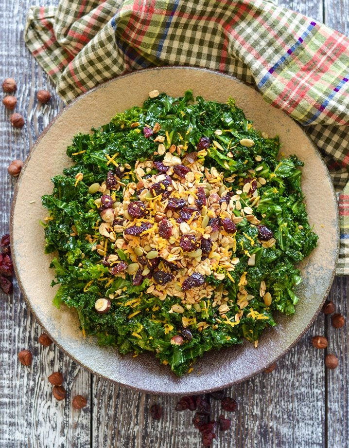 massaged kale salad scattered with savoury granola