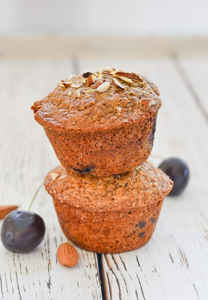 Buttery, moist, soft Almond Cherry Muffins stacked on top of each other