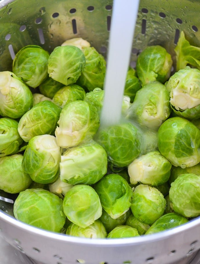 Washing Brussels Sprouts in preparation for my Cranberry Pecan Brussels Sprout Salad