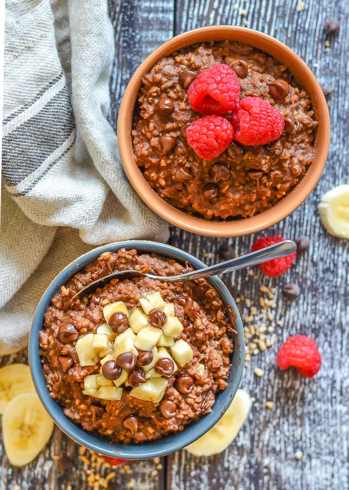 Healthy Chocolate Instant Pot Steel Cut Oats in bowls and topped with fruit and chocolate chips. Photo taken from above.