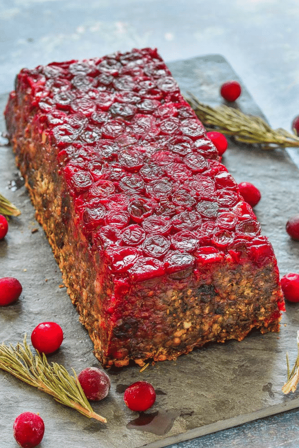 A fresh take on a Vegan Lentil Loaf for you! It's made with a delicious blend of lentils, mushrooms and walnuts and has a beautifully festive cranberry topping. Those pops of juicy cranberry in every bite are so good, plus they make it look pretty impressive. It would make a great centrepiece on your holiday table! #vegan #lentilloaf #veganmeatloaf #Christmas #Thanksgiving #vegetarian