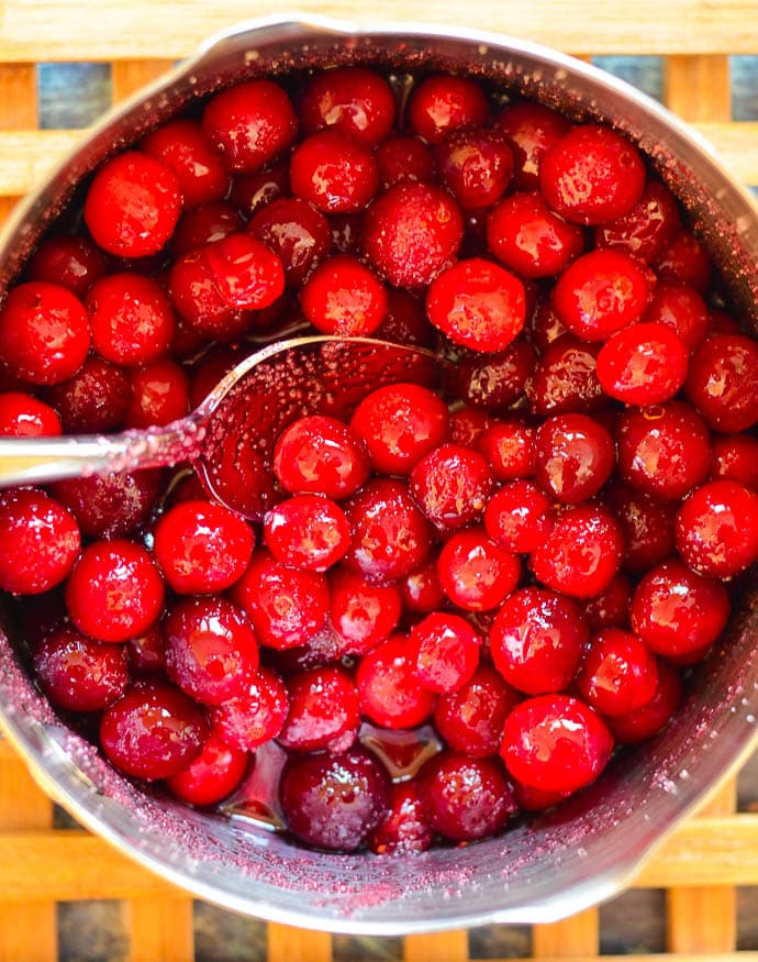 cranberries and sugar cooked gently in a pan