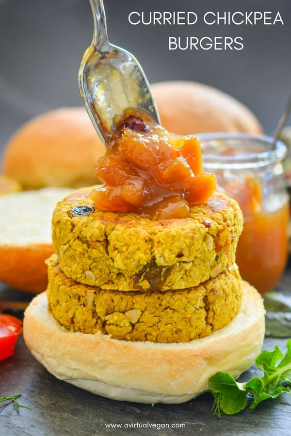 Quick & easy Curried Chickpea Burgers. They are full of curry flavour with bursts of sweetness from plump golden raisins and texture from chopped cashew nuts & chewy oats. Serve them in buns with a generous dollop of mango chutney! #veggieburger #chickpeas #curryburger #curry #vegan #chickpeaburger