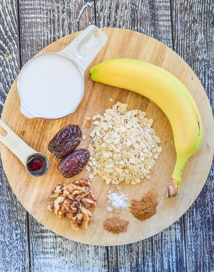 Ingredients to make a Creamy Banana Smoothie laid out on a board