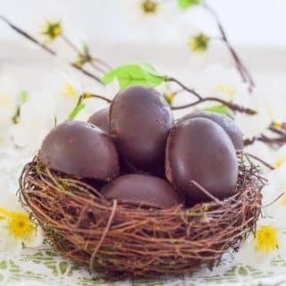 Vegan Caramel Eggs nestled in a faux bird's nest