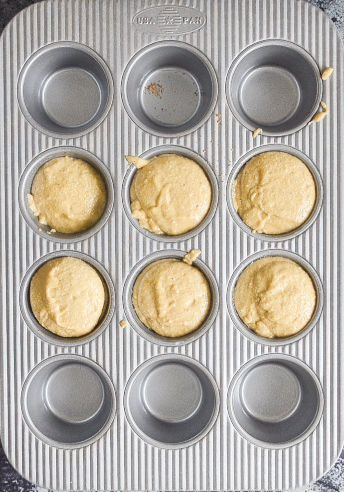 pineapple upside down cupcakes in muffin pan prior to baking