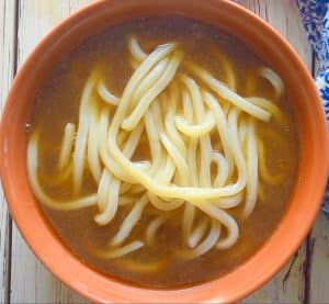 udon noodle and broth in a bowl
